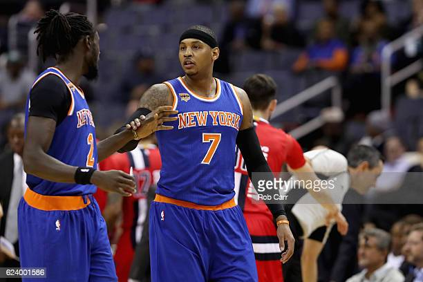 Carmelo Anthony of the New York Knicks talks with teammate Maurice Daly Ndour against the Washington Wizards at Verizon Center on November 17 2016 in...