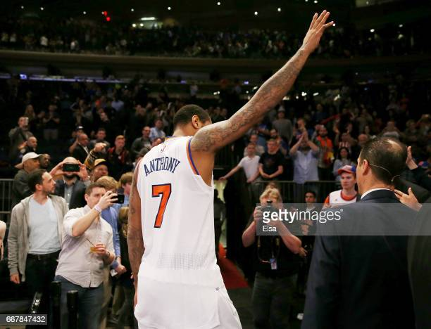 Carmelo Anthony of the New York Knicks waves to the fans as he walks off the court after the 114113 win over the Philadelphia 76ers at Madison Square...
