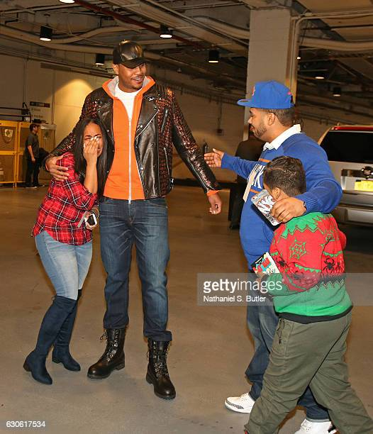 Carmelo Anthony of the New York Knicks with the Carmelo Anthony Foundation the Garden of Dreams Foundation and Kia gave a new car to Jarell Lara and...