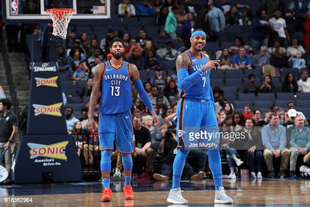 Carmelo Anthony of the Oklahoma City Thunder and Paul George of the Oklahoma City Thunder look on during the game against the Memphis Grizzlies on...
