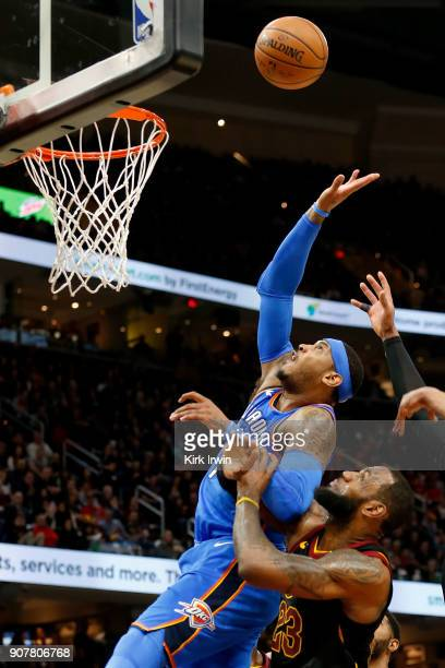 Carmelo Anthony of the Oklahoma City Thunder attempts to grab a rebound over LeBron James of the Cleveland Cavaliers during the second quarter at...