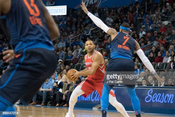 Carmelo Anthony of the Oklahoma City Thunder blocks Eric Gordon of the Houston Rockets during the second half of a NBA game at the Chesapeake Energy...