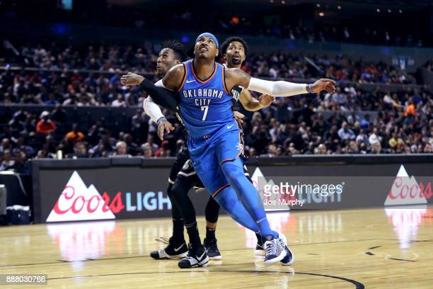 Carmelo Anthony of the Oklahoma City Thunder boxes out against the Brooklyn Nets as part of the NBA Mexico Games 2017 on December 7 2017 at the Arena...