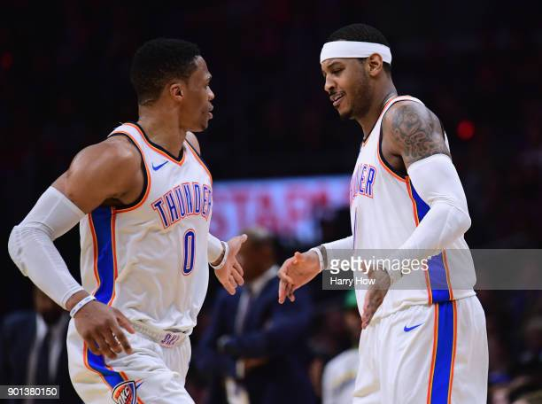 Carmelo Anthony of the Oklahoma City Thunder celebrates his three pointer with Russell Westbrook during a 127117 win over the LA Clippers at Staples...