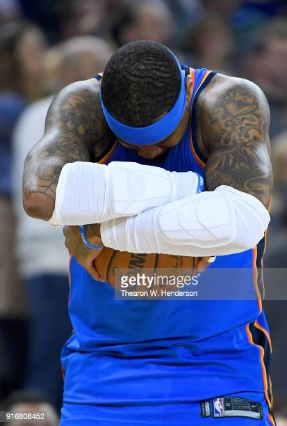 Carmelo Anthony of the Oklahoma City Thunder cradles the ball prior to the start of an NBA basketball game against the Golden State Warriors at...