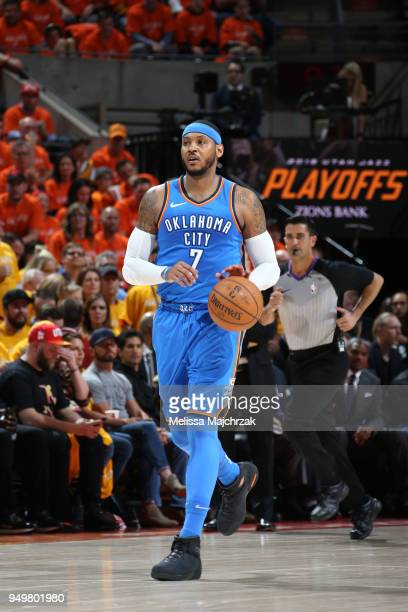 Carmelo Anthony of the Oklahoma City Thunder dribbles the ball up the court against the Utah Jazz in Game Three of Round One of the 2018 NBA Playoffs...