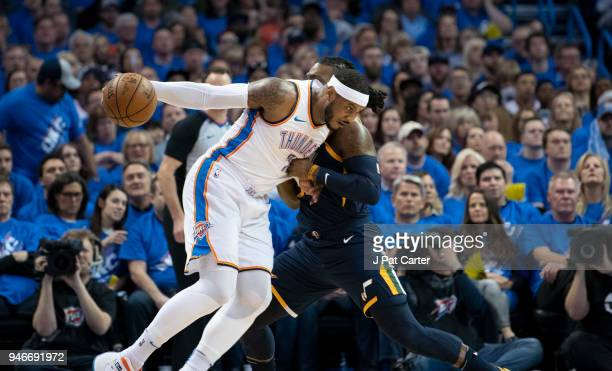 Carmelo Anthony of the Oklahoma City Thunder drives against Jae Crowder of the Utah Jazz during the first half of Game 1 of the Western Conference...
