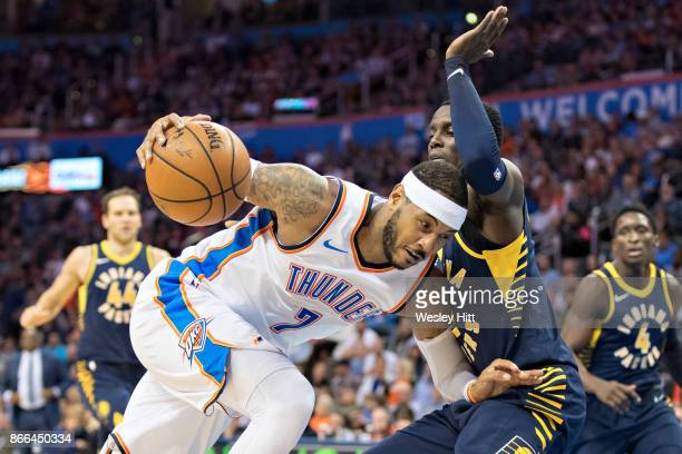 Carmelo Anthony of the Oklahoma City Thunder drives to the basket against Victor Oladipo of the Indiana Pacers at the Chesapeake Energy Arena on...