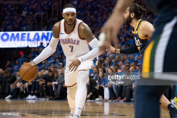 Carmelo Anthony of the Oklahoma City Thunder drives Utah Jazz players during the second half of Game One of the Western Conference in the 2018 NBA...