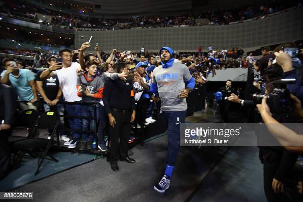 Carmelo Anthony of the Oklahoma City Thunder enters the court before the game against the Brooklyn Nets as part of the NBA Mexico Games 2017 on...