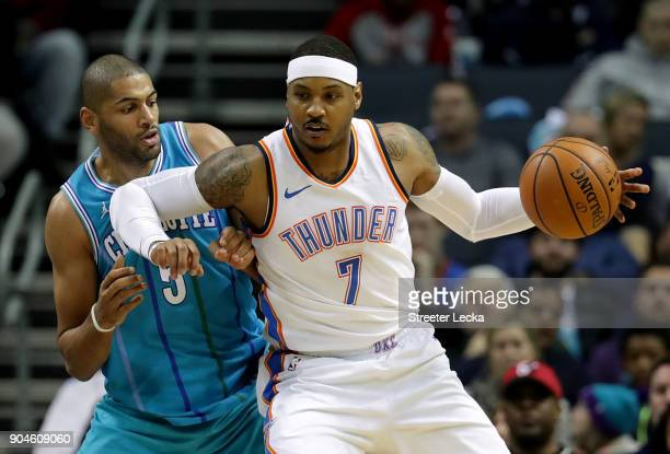 Carmelo Anthony of the Oklahoma City Thunder goes to the basket against Nicolas Batum of the Charlotte Hornets during their game at Spectrum Center...
