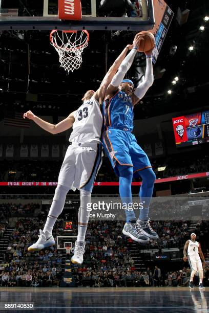 Carmelo Anthony of the Oklahoma City Thunder grabs the rebound against the Memphis Grizzlies on December 9 2017 at FedExForum in Memphis Tennessee...