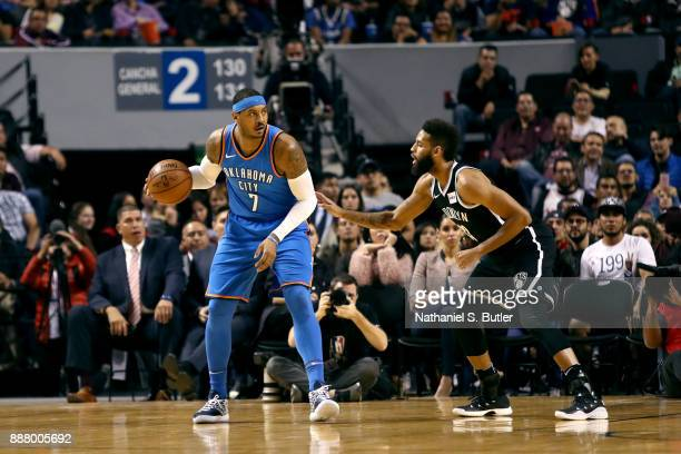 Carmelo Anthony of the Oklahoma City Thunder handles the ball against the Brooklyn Nets as part of the NBA Mexico Games 2017 on December 7 2017 at...