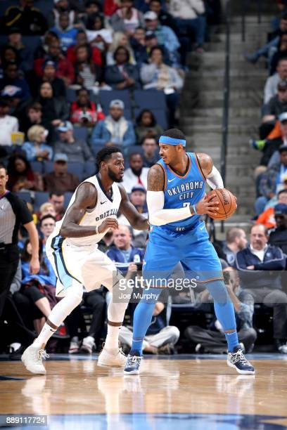 Carmelo Anthony of the Oklahoma City Thunder handles the ball against the Memphis Grizzlies on December 9 2017 at FedExForum in Memphis Tennessee...