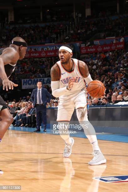 Carmelo Anthony of the Oklahoma City Thunder handles the ball against the Sacramento Kings on March 12 2018 at Chesapeake Energy Arena in Oklahoma...