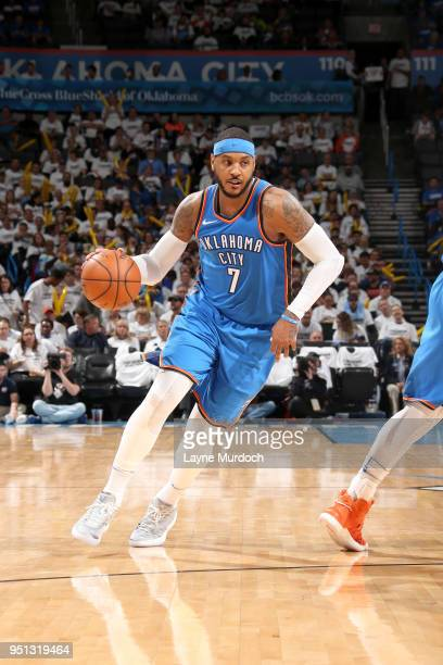 Carmelo Anthony of the Oklahoma City Thunder handles the ball against the Utah Jazz in Game Five of Round One of the 2018 NBA Playoffs on April 25...