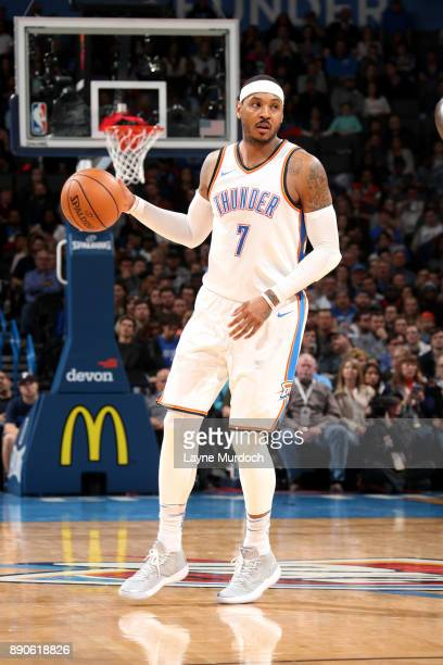 Carmelo Anthony of the Oklahoma City Thunder handles the ball during the game Charlotte Hornets on December 11 2017 at Chesapeake Energy Arena in...