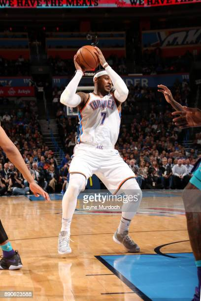 Carmelo Anthony of the Oklahoma City Thunder handles the ball during the game against the Charlotte Hornets on December 11 2017 at Chesapeake Energy...