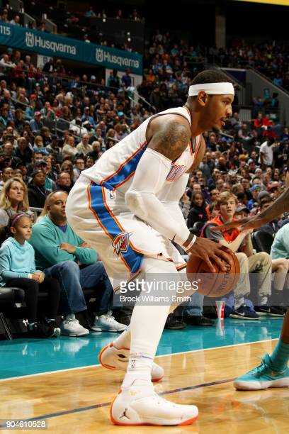 Carmelo Anthony of the Oklahoma City Thunder handles the ball during the game against the Charlotte Hornets on January 13 2018 at Spectrum Center in...