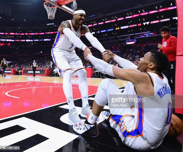 Carmelo Anthony of the Oklahoma City Thunder helps up Russell Westbrook of the Oklahoma City Thunder during a 127117 Thunder win over the LA Clippers...