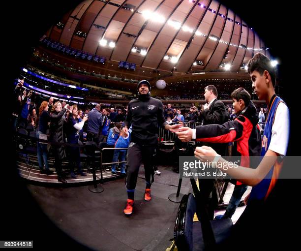 Carmelo Anthony of the Oklahoma City Thunder high fives fans before the game against the New York Knicks on December 16 2017 at Madison Square Garden...