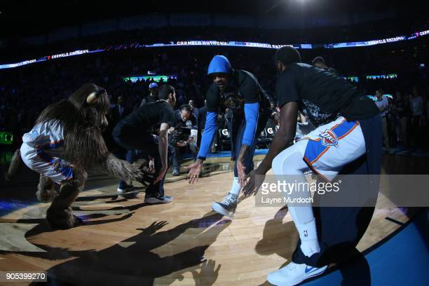 Carmelo Anthony of the Oklahoma City Thunder high fives his teammates before the game against the Sacramento Kings on January 15 2018 at Chesapeake...