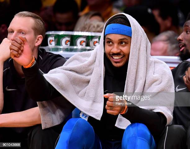 Carmelo Anthony of the Oklahoma City Thunder laughs from the bench during a 13396 win over the Los Angeles Lakers at Staples Center on January 3 2018...