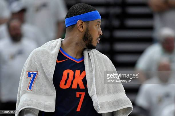 Carmelo Anthony of the Oklahoma City Thunder looks on during Game Four of Round One of the 2018 NBA Playoffs against the Utah Jazz at Vivint Smart...