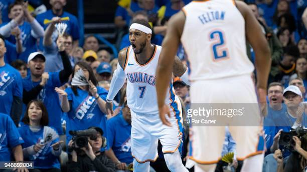 Carmelo Anthony of the Oklahoma City Thunder reacts after scoring against the Utah Jazz during the first half of Game 1 of the Western Conference...