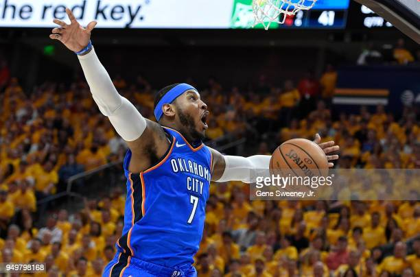 Carmelo Anthony of the Oklahoma City Thunder reacts to his basket in the first half during Game Three of Round One of the 2018 NBA Playoffs against...