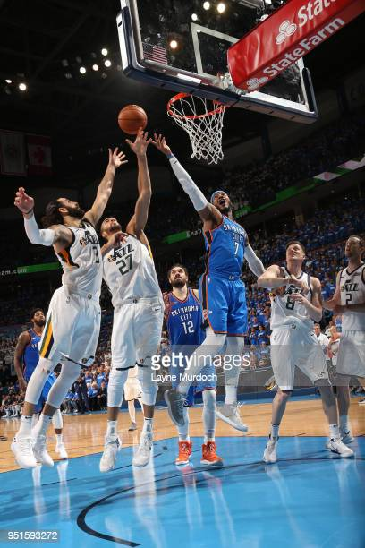 Carmelo Anthony of the Oklahoma City Thunder Rudy Gobert of the Utah Jazz and Ricky Rubio of the Utah Jazz reach for the rebound during the game...