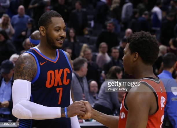 Carmelo Anthony of the Oklahoma City Thunder shakes hands with Kyle Lowry of the Toronto Raptors following an NBA game at Air Canada Centre on March...