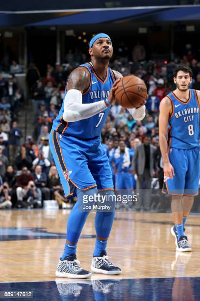 Carmelo Anthony of the Oklahoma City Thunder shoots a free throw against the Memphis Grizzlies on December 9 2017 at FedExForum in Memphis Tennessee...