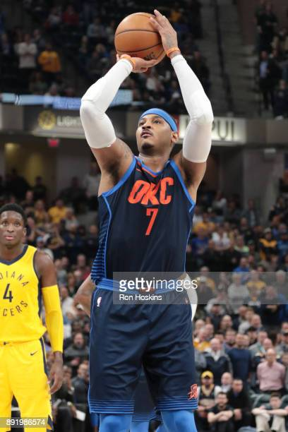 Carmelo Anthony of the Oklahoma City Thunder shoots a free throw against the Indiana Pacers on December 13 2017 at Bankers Life Fieldhouse in...