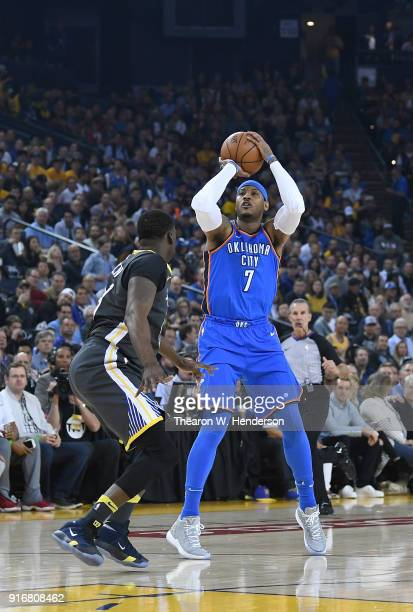 Carmelo Anthony of the Oklahoma City Thunder shoots over Draymond Green of the Golden State Warriors during the first half of their NBA basketball...