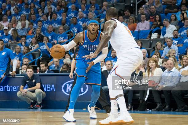 Carmelo Anthony of the Oklahoma City Thunder shoots over Kyle O'Quinn of the New York Knicksduring the first half of a NBA game at the Chesapeake...