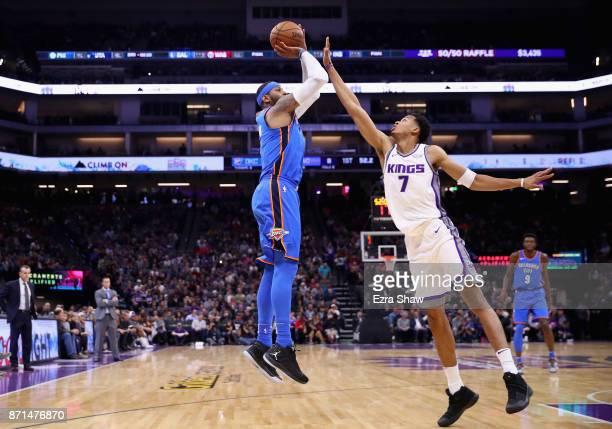 Carmelo Anthony of the Oklahoma City Thunder shoots over Skal Labissiere of the Sacramento Kings at Golden 1 Center on November 7 2017 in Sacramento...