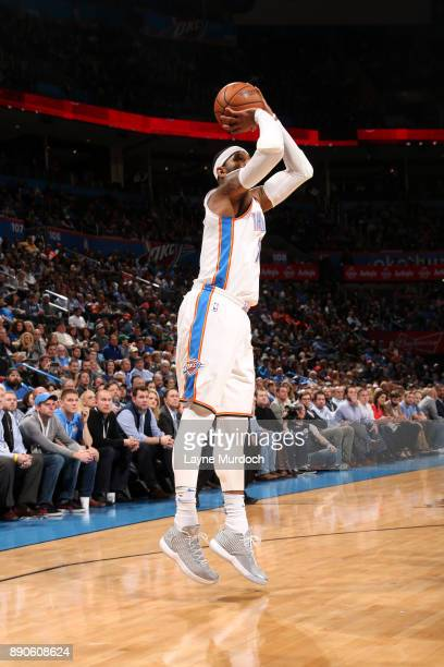 Carmelo Anthony of the Oklahoma City Thunder shoots the ball during the game against the Charlotte Hornets on December 11 2017 at Chesapeake Energy...