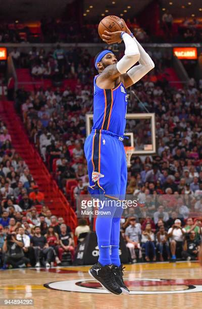 Carmelo Anthony of the Oklahoma City Thunder shoots the ball during the game against the Miami Heat at American Airlines Arena on April 9 2018 in...