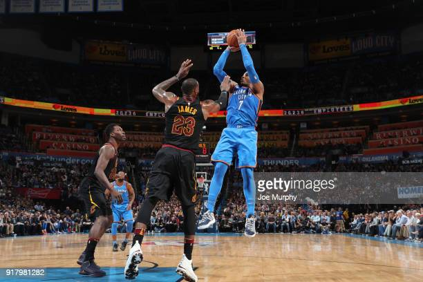 Carmelo Anthony of the Oklahoma City Thunder shoots the ball over LeBron James of the Cleveland Cavaliers during the game on February 13 2018 at...