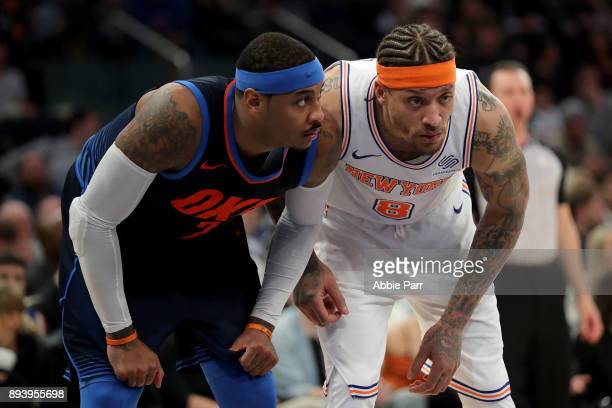 Carmelo Anthony of the Oklahoma City Thunder stands alongside Michael Beasley of the New York Knicks in the fourth quarter during their game at...