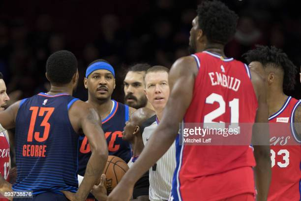 Carmelo Anthony of the Oklahoma City Thunder stares at Joel Embiid of the Philadelphia 76ers in the fourth quarter at the Wells Fargo Center on...
