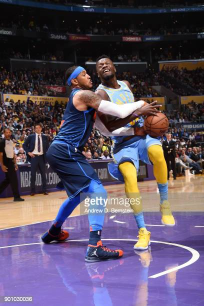 Carmelo Anthony of the Oklahoma City Thunder stops the ball against Julius Randle of the Los Angeles Lakers on January 3 2018 at STAPLES Center in...