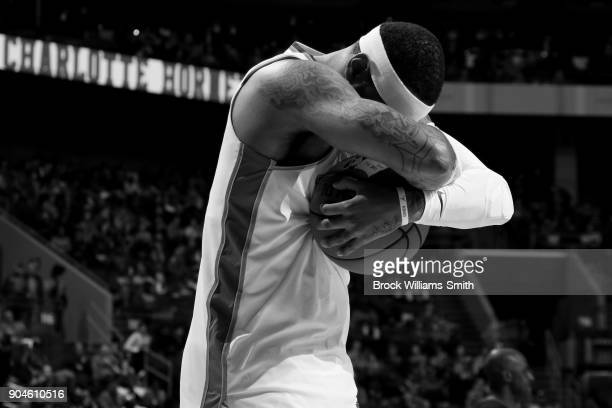 Carmelo Anthony of the Oklahoma City Thunder takes a moment prior to the game before the game against the Charlotte Hornets on January 13 2018 at...