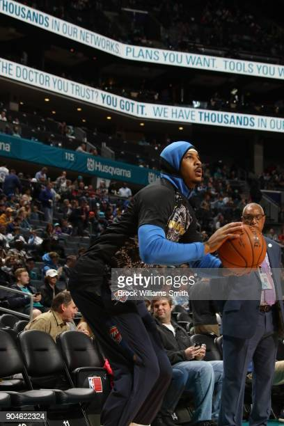 Carmelo Anthony of the Oklahoma City Thunder warms up prior to the game against the Charlotte Hornets on January 13 2018 at Spectrum Center in...