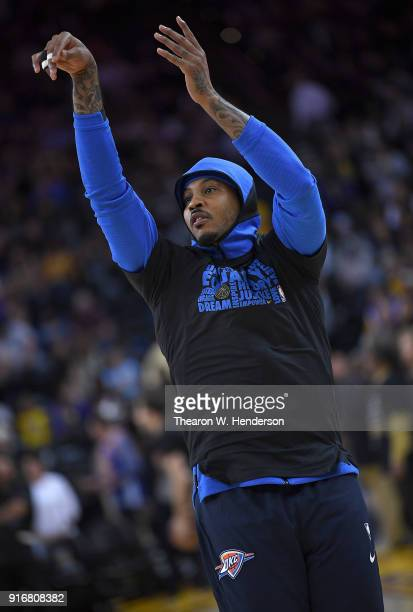 Carmelo Anthony of the Oklahoma City Thunder warms up prior to the start of an NBA basketball game against the Golden State Warriors at ORACLE Arena...