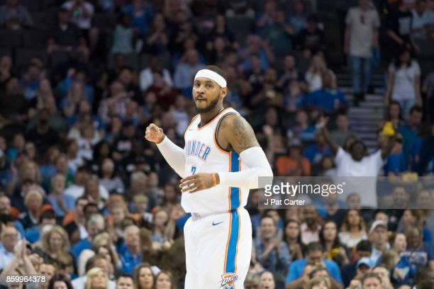 Carmelo Anthony of the Oklahoma City Thunder watches game action against Melbourne United during the first half of a NBA preseason game at the...