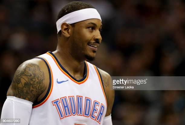 Carmelo Anthony of the Oklahoma City Thunder watches on against the Charlotte Hornets during their game at Spectrum Center on January 13 2018 in...