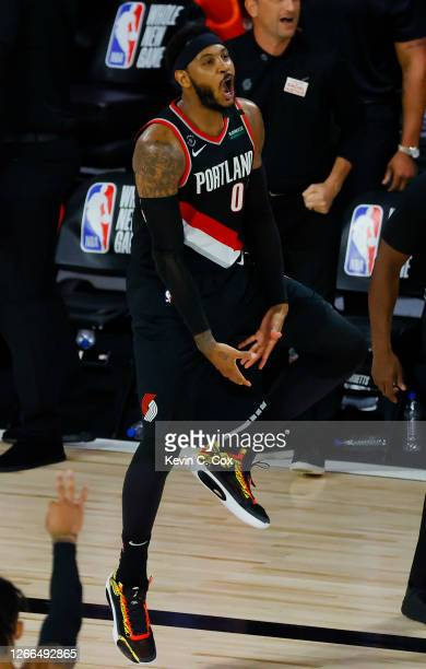 Carmelo Anthony of the Portland Trail Blazers celebrates a three point shot against the Memphis Grizzlies during the fourth quarter in the Western...