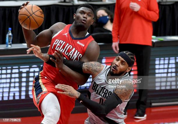 Carmelo Anthony of the Portland Trail Blazers fouls Zion Williamson of the New Orleans Pelicans during the second half at Moda Center on March 16,...